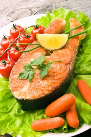 Photo for Salmon steak with vegetables - Royalty Free Image
