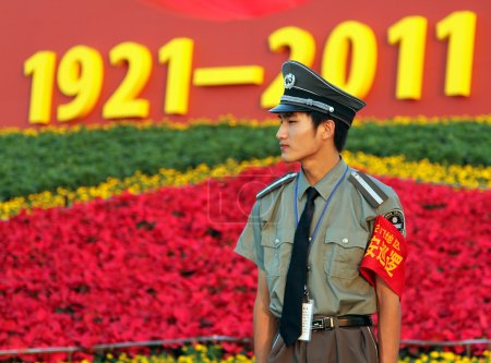 BEIJING - July 3: a soldier stands guard at the entrance to the