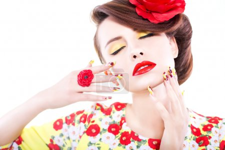 Brunette woman in yellow and red dress with poppy flower in her hair, poppy ring and creative nails, closed eyes. Copy space on white background