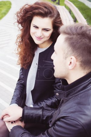Photo for Couple holding hands and smiling outdoors - Royalty Free Image