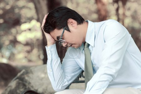 Photo for Asian men stress and hold the head with hand - Royalty Free Image
