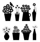 Black and white flower icons in vase with birds