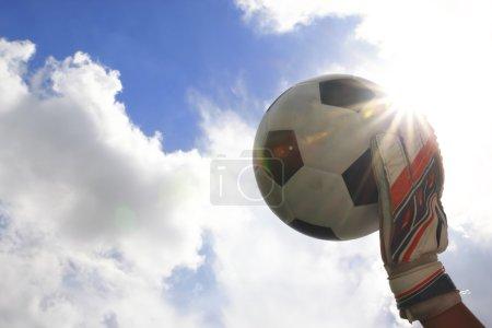 Soccer goalkeeper's hands reaching for the ball