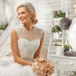 The beautiful  woman posing in a wedding dress...