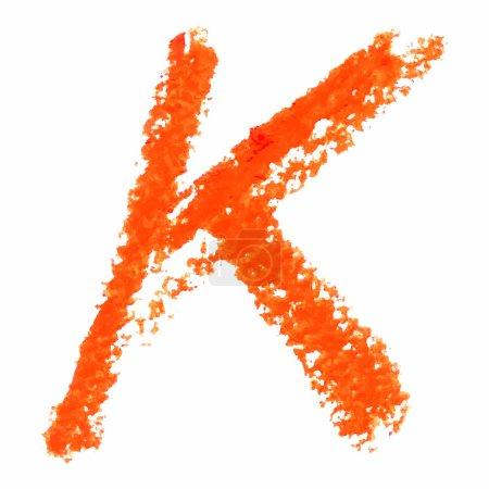 K - Orange handwritten letters on white background.