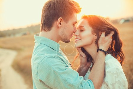 Photo for Young couple in love outdoor.Stunning sensual outdoor portrait of young stylish fashion couple posing in summer in field - Royalty Free Image