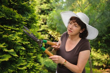 Female gardener with clippers...