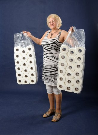 Woman with big packs of toilet paper