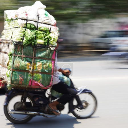 Big load of fresh greens, oversized transport by motorbike