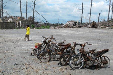 Burnt motorbike wrecks after volcano eruption