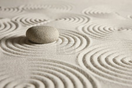 Photo for Stone surrounded by sand ripples - Royalty Free Image