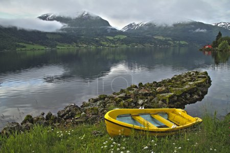 Yellow boat in a norwegian fjord, Norway