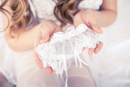 The bride holds the garter.