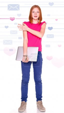 Red-haired girl with laptop on the background with hearts and letters