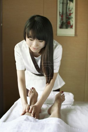 Photo for Massage Therapist Massaging Feet - Royalty Free Image