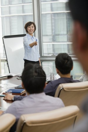 Woman Giving Business Presentation