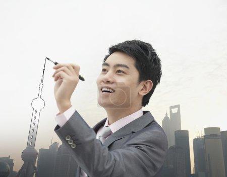 Businessman drawing Shanghai skyline