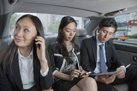 Business People in Car Back