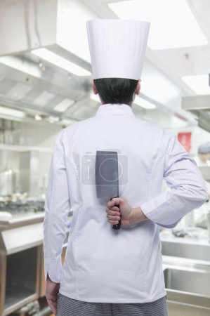 Chef with Knife Behind his Back