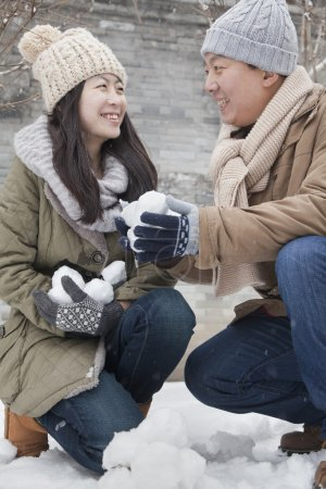Couple Holding snow balls