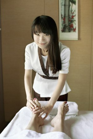 Massage Therapist Massaging Feet