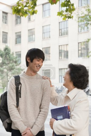 Photo for Student talking with his professor - Royalty Free Image