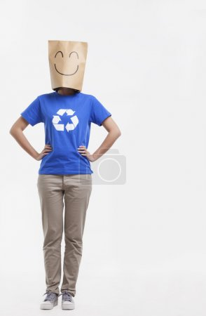 Woman with smiley face paper bag over her head
