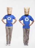 People with smiley face paper bags over their head