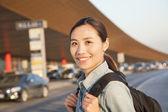 Traveler portrait outside of airport