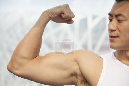Man flexing his bicep