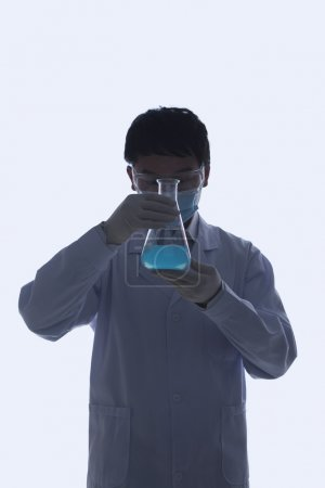 Scientist Looking at Beaker