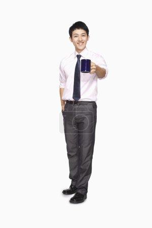 Businessman smiling with mug