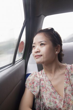 Woman Looking Out Window In Taxi