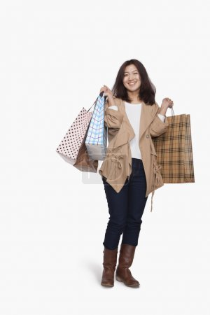 Photo for Young woman with shopping bags - Royalty Free Image