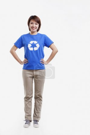 Woman wearing recycling symbol T-shirt