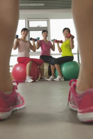 Mature women exercising with fitness ball