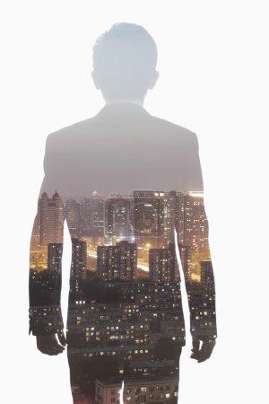Businessman and the skyline of Shanghai