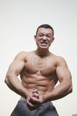 Muscular Man Growling and Flexing Shirtless