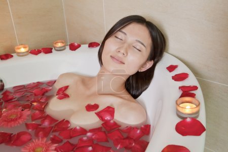 Woman Bathing at Health Spa