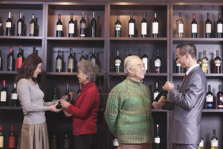 People Examining Wine at a Wine Store