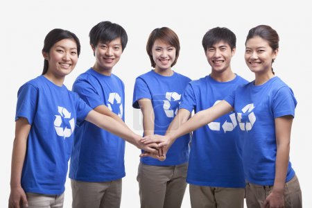 People in recycling t-shirts with hands together