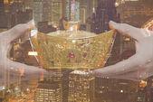 Holding Chinese New Year Gold Ingot
