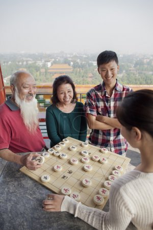 Chinese Family Playing Chinese Chess (Xiang Qi)...