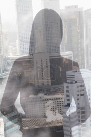 Young woman over cityscape