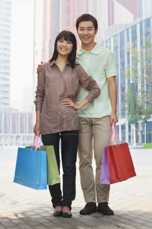Couple walking with shopping bags in hands