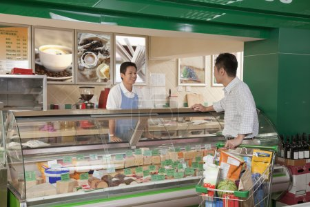 Sales Clerk assisting man at the Deli counter