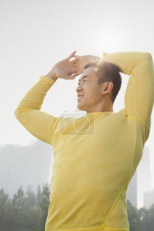 Muscular Man Stretching
