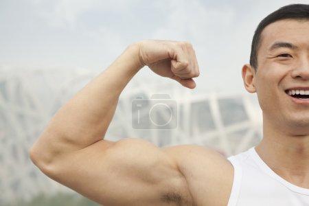 Man flexing his bicep