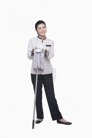 Photo for Young female caretaker with mop, studio shot - Royalty Free Image