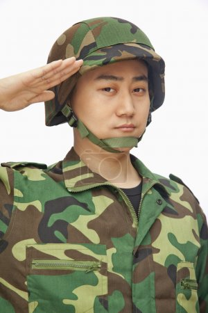 Photo for Portrait of man in military uniform saluting - Royalty Free Image